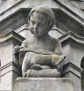 child_reading_wikimedia_commons