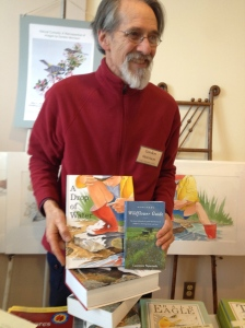Author and Illustrator Gordon Morrison with two of his works, at MEES Conference, Spring 2014.