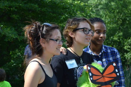 Martine Wong, left, with volunteer Lisa and MSYEP intern Shewit, at the Monarch Release event at Lusitania Meadow, Fresh Pond Reservation.